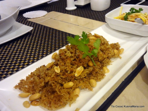Crispy Catfish with Green Mango Salad by Tio Cococ's Bar and Restaurant